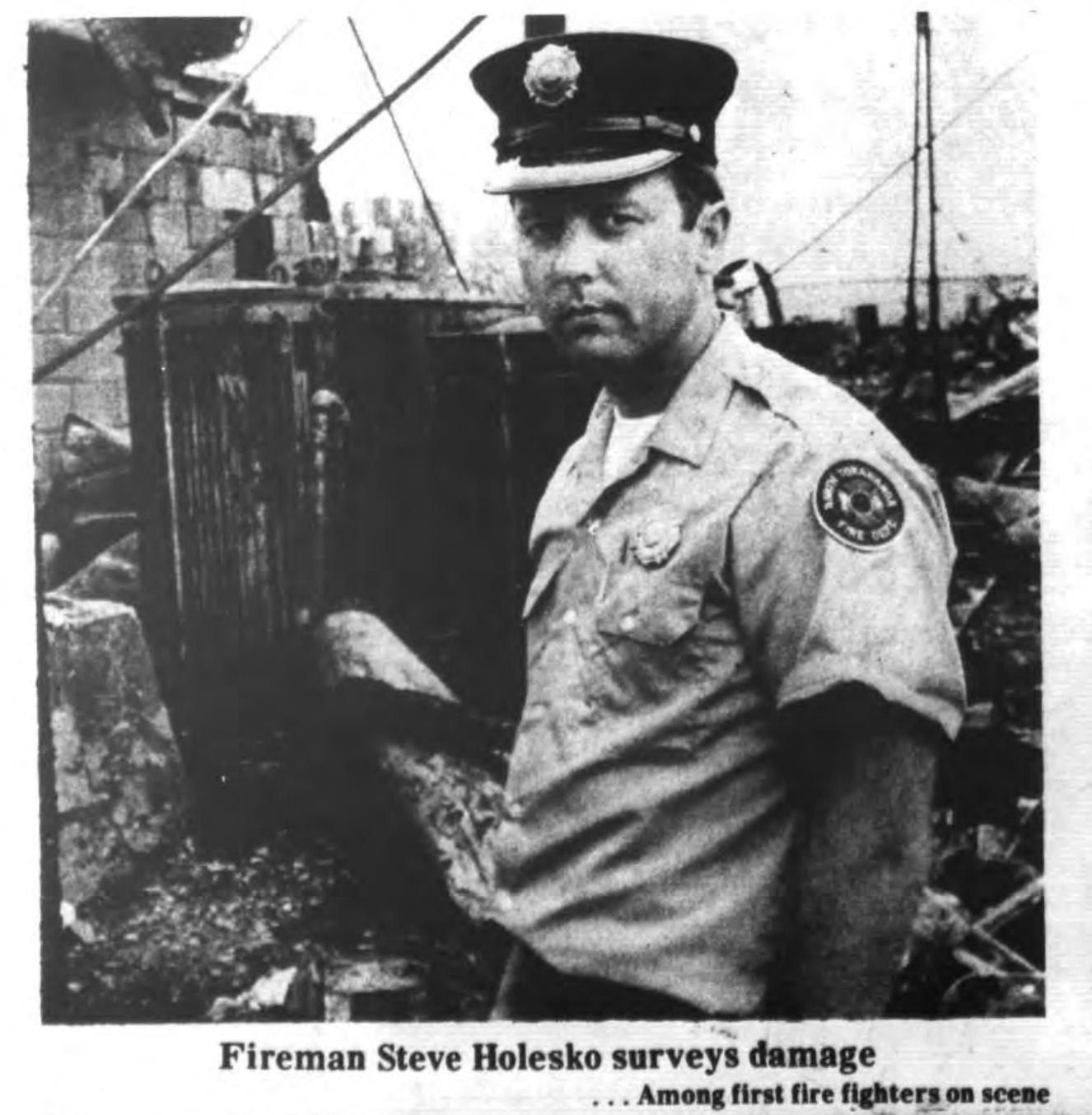 Fireman surveys damage, Auto-Wheel fire, photo (Tonawanda News, 1972-05-31).jpg