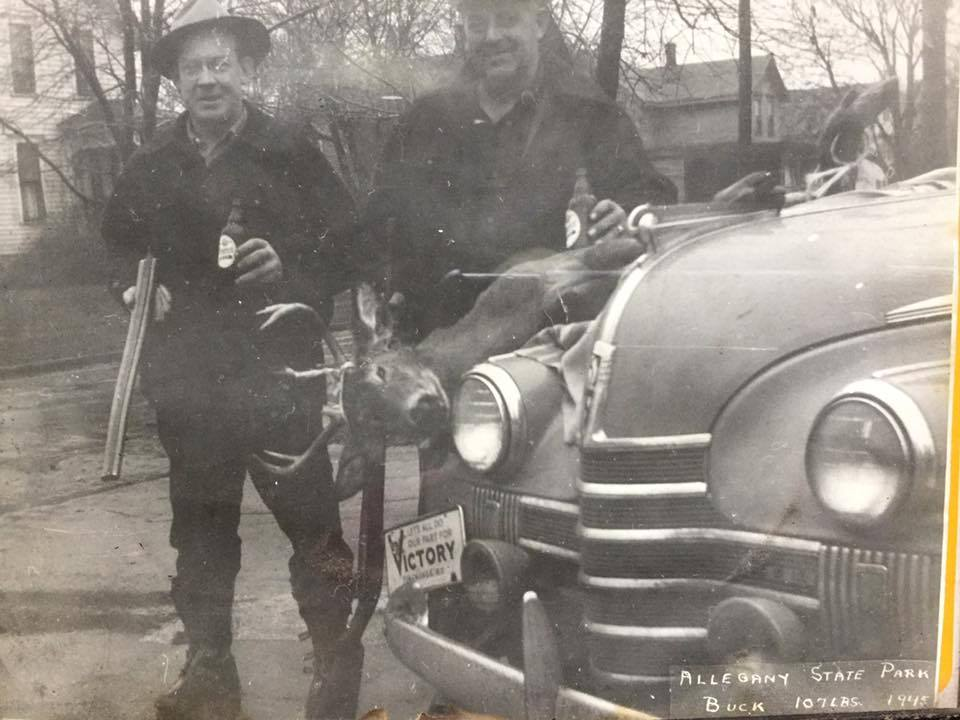 Men with beer and guns showing off deer, Martinsville, photo (1945).jpg