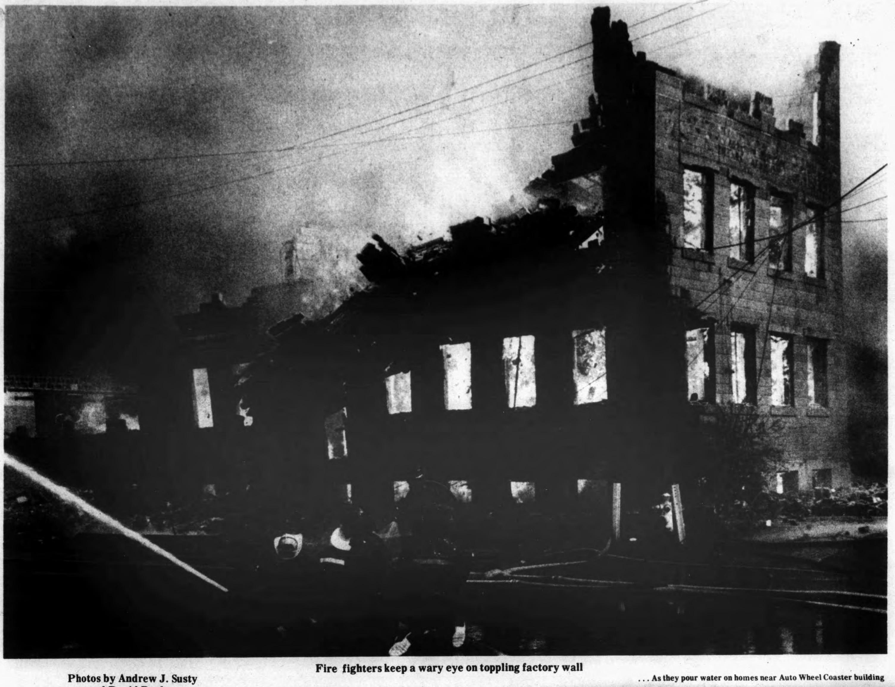 Firefighters keep eye on toppling factory wall, photo (Tonawanda News, 1972-05-30).jpg