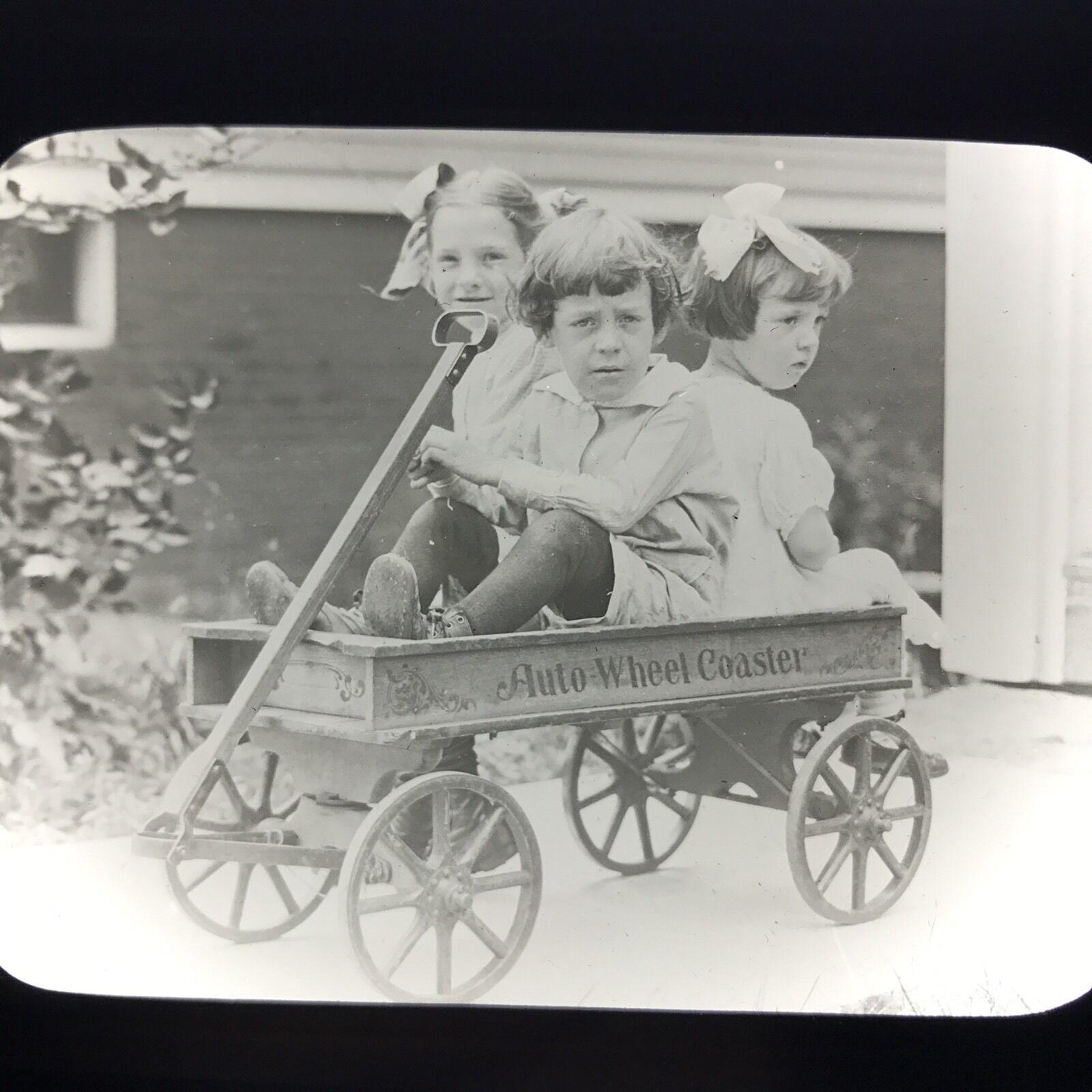 Girls in Auto-Wheel Coaster, magic lantern slide (c.1920).jpg