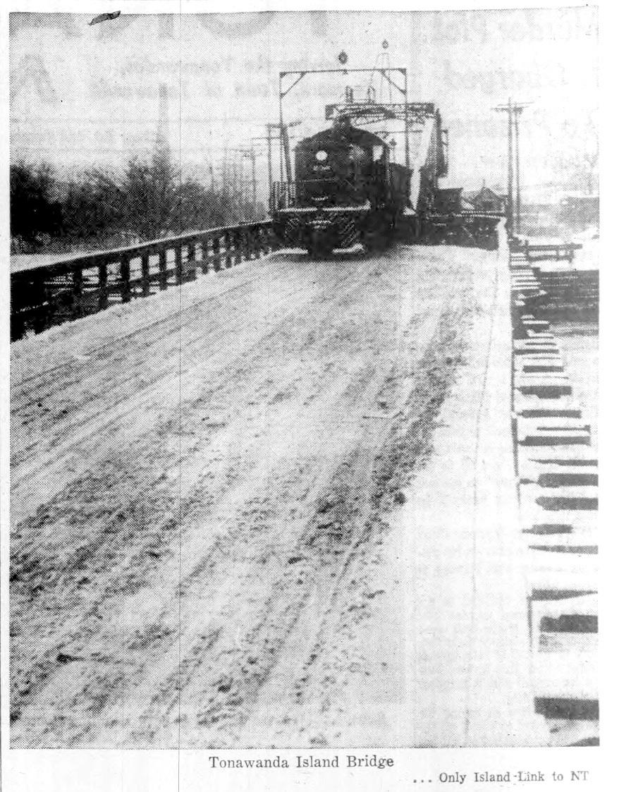 Swing bridge with train, photo from article (Tonawanda News, 1961-02-08).jpg