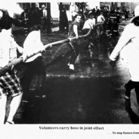 Volunuteers carry hose, Auto-Wheel fire, photo (Tonawanda News, 1972-05-30).jpg