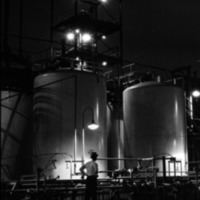 Du Pont storage tanks for adiponitrile at night, photo (Hagley Archive, c1951).png