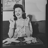 Van Raalte Co, woman models silk gloves during wartime conversion, photo (LOC 1942).jpg